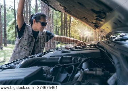 Asian Man Opening The Bonnet Of His Pickup Truck To Check The Condition Of The Engine Failure, To Be