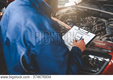 Car Mechanic Inspecting Vehicle. Auto Inspection Concept