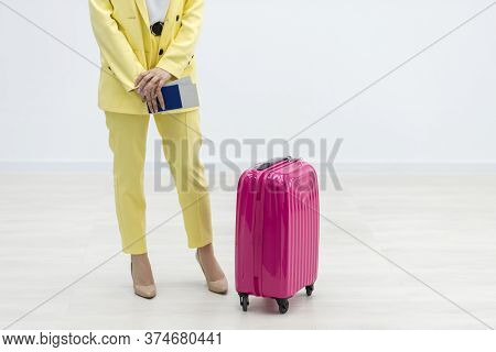A Woman With Suitcase In The Waiting Room, Wait For Flight.
