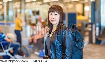 Woman Solo Traveller With Backpack In The Airport. Baner.