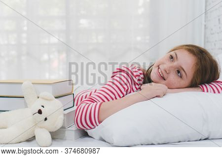 Young Girl Daydreaming To Future At Home.