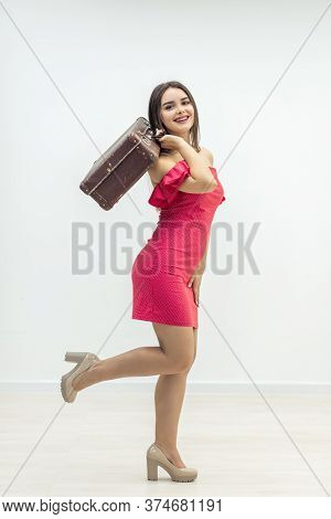 Full-length Photo Of Pretty Woman With Baggage Saying Bye Bye Over White Background.