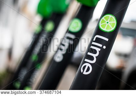 Bucarest, Romania - May 26. 20202: Image Of Some Lime-s E-scooters Parked On Sidewalk In Bucharest,