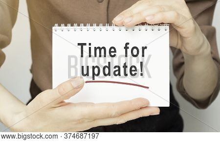 Business Woman Holding Tear Paper With Time For Update Text