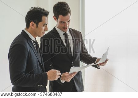 Business Team Casual Meeting And Discussing In Workplace.