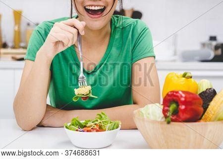 Eat Green Salad For Wellness. Young Woman Enjoy Eating Vegan.