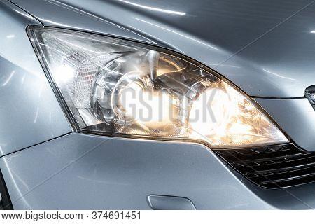 Novosibirsk/ Russia - April 22 2020: Honda Cr-v, Blue Car Headlights. Exterior Detail. Close Up Deta