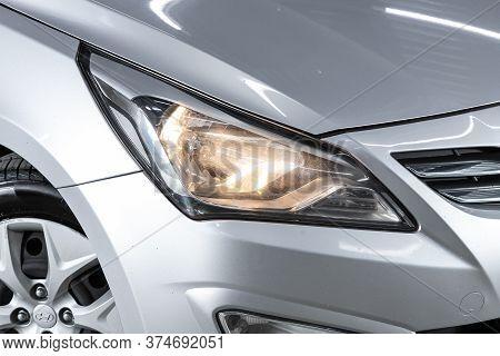 Novosibirsk/ Russia - June 23  2020:  Hyundai Solaris, Silver Car Headlights. Exterior Detail. Close