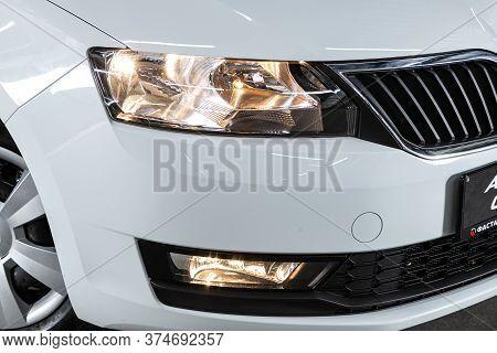Novosibirsk/ Russia - June 30  2020:  Scoda Rapid, White Car Headlights. Exterior Detail. Close Up D
