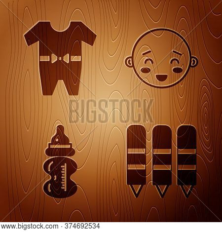 Set Wax Crayons For Drawing, Baby Clothes, Baby Bottle And Happy Little Boy Head On Wooden Backgroun