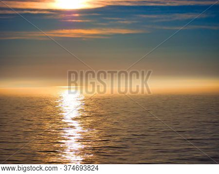 Beautiful Yellow Sunset And Foggy Sky Reflection In Canada