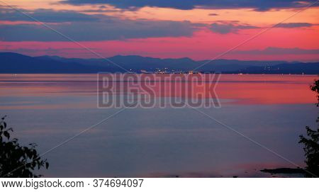 Colorful Sunset Summer View. Beautiful Sea And Sky Reflection With Dramatic Clouds Over The Sea And
