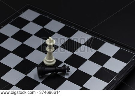 Chess Game Finish On Chessboard. Victorious And Defeated King Figure. Chess Figurine Order. Checkmat