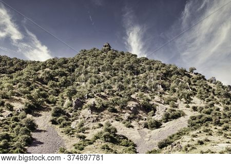 Rajasthan, India - October 06, 2012: A Landscape Of Hilly Mountains Surrounding Abandoned Cursed Rui
