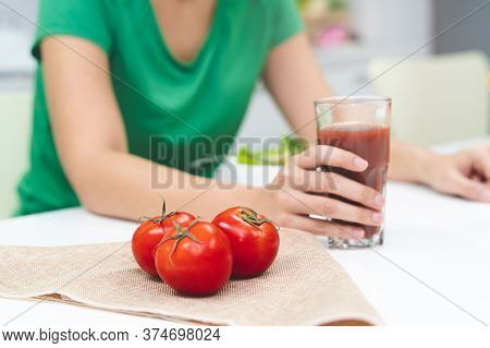 Low Calories Drink For Wellness. Woman Making Homemade Drink By Extracting Fresh Tomato Juice.