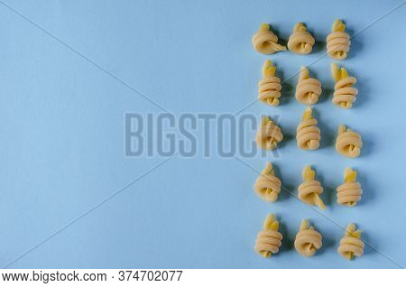 Creative Background With Insalatonde Pasta On A Light Blue Background. Geometric Shapes And Lines Fr