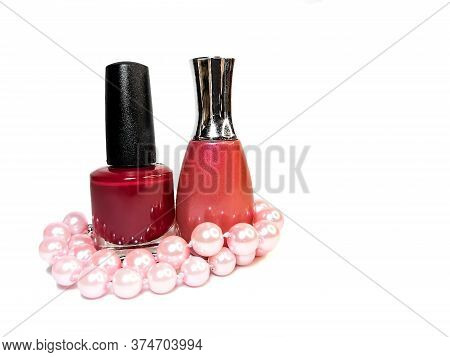 Two Nail Polish Bright Color Shades Of Red And Pink Pearl Beads Isolated On White Background. Nail C