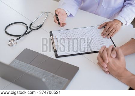 Doctor Giving Consulting And Diagnostic To Patient And Explaining Medical Informations Prevention Di