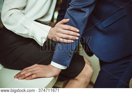 Sexual Relations At Work. Young Business Couple Are Having Sexual Activities In Workplace. Woman Sed