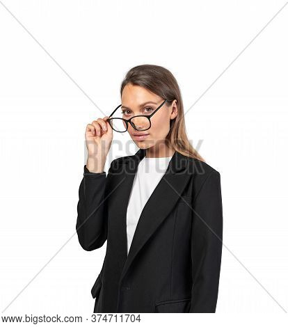 Isolated Portrait Of Beautiful Young European Businesswoman With Long Fair Hair Taking Off Her Glass