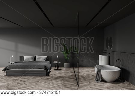 Interior Of Stylish Hotel Bedroom With Gray And Stone Walls, Wooden Floor, Comfortable King Size Bed