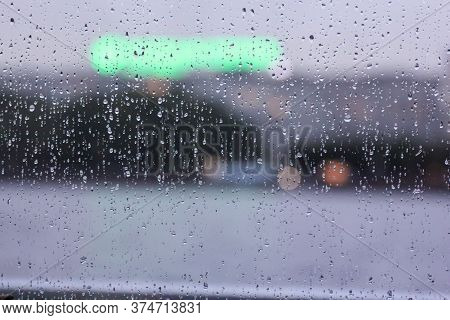 Neon Sign Behind Wet Glass. Views Of The Neva From The Window Of A Floating Restaurant.