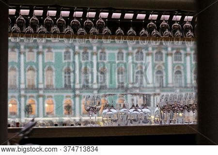 View Of The Hermitage Framed By Glasses. Views Of The Neva From The Window Of A Floating Restaurant.