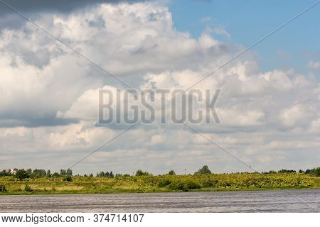 Clouds Over The River Bank. Nature On The Banks Of The Volkhov River.
