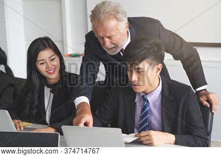 Boss Mentoring To Intern Employee In The Office