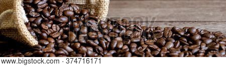 Roasted Arabica Coffee Beans Background On Wooden Table.arabica Coffee Is The World's Most Popular T