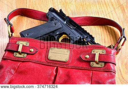 Ladys Handbag Packing Pistol For Self Defense.