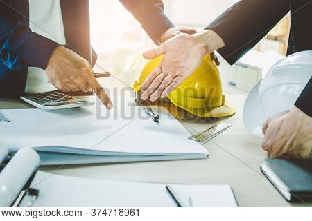 Close Up Hands Of Businessman From Consultancy Service Discussing With Project Contractor And Review