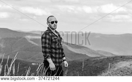 Value Of Freedom. Self Sufficient. Man Stand On Top Of Mountain. Hiking Concept. Active Leisure. Guy