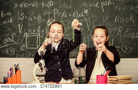 Basic Knowledge Of Chemistry. Girls Study Chemistry. Make Studying Chemistry Interesting. Microscope