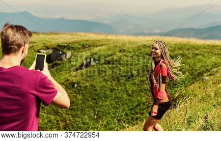 Young Adventurers. Couple Taking Photo. Couple In Love Hiking Mountains. Lets Take Photo. Capturing