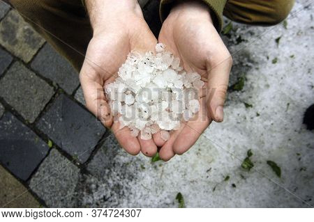 Holding Hail Stones In Hand After Hailstorm