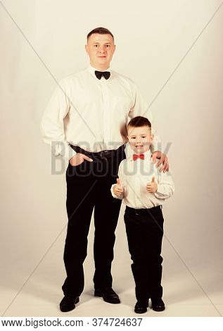Father And Son Formal Clothes Outfit. Formal Event. Grow Up Gentleman. Dad And Boy With Bow Ties. Ge