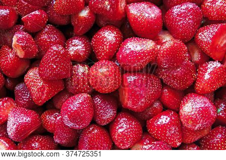 Background From Freshly Harvested Strawberries, Directly Above On Blue Background