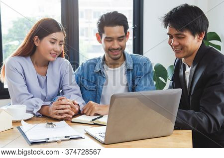 New House / Home Moving And Relocation Concept. Happy Asian Couple Talking With Apartment Landlord F