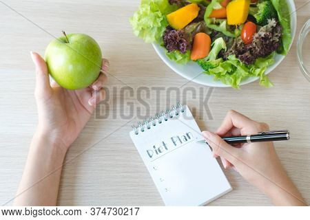 Dieting And Calorie Control For Wellness. Woman Calculate Calories Of Food In Breakfast During Dieti