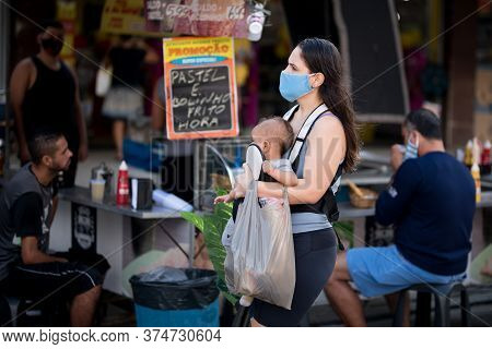 Rio De Janeiro, Brazil - July 3, 2020: People Are Wearing Face Masks During The Coronavirus Pandemic