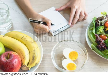 Dieting And Calories Control For Wellness. Woman Using Smartphone Calculate Calories Of Food In Brea