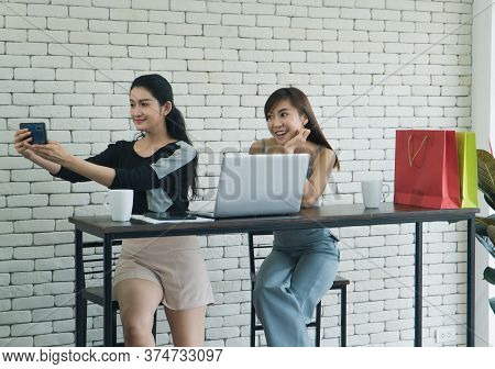 Two Interesting Asian Women Were Friends Talking About Coffee In A Coffee Shop. Two Women Sipping Co
