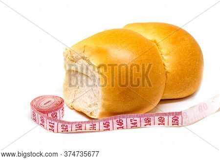 Bakery And Tailors Centimeter On White Background. Diet And Weight Loss Concept Photo. Sweet Bread B
