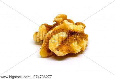 Natural Walnut On White Background. Cracked And Cleaned Nut Kernel. Simple Organic Food. Tasty Healt