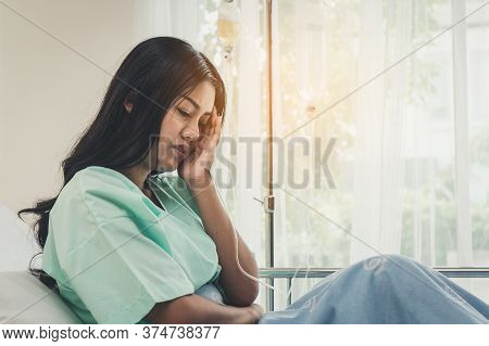 Sadness Woman Depressed After Have A Cancer In Her Body. Young Girl Covering Her Face And Crying On