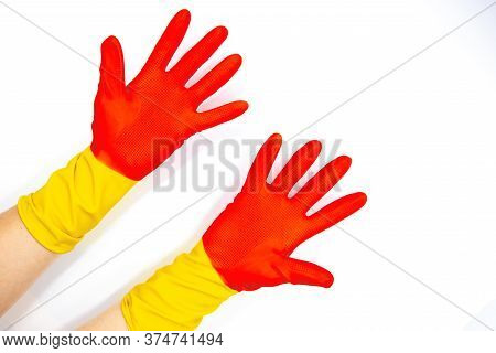 Open Hands In Rubber Gloves On White Background. Red Yellow Rubber Glove For Everyday Household Chor