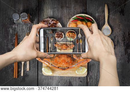 Girl Taking Pictures On Mobile Smart Phone A Jumbo Crab And Spices Herb On Dark Background