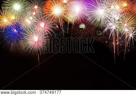 Several Fireworks Stacked. In The Middle Of The Space, Write A Message Happy New Year.