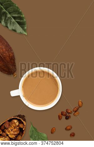 Mug Of Cacao Hot Drink With Cocoa Pods, Cacao Powder, Cacao Beans, On A Brown Background, Flat Lay F